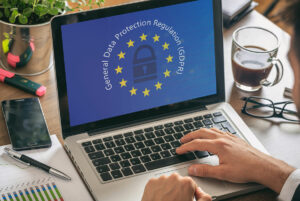 person on computer with GDPR on screen