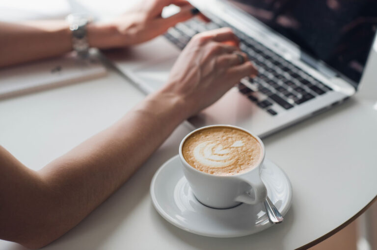 web designer with coffee and computer